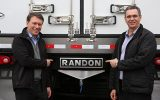 Wilson Lirmann, presidente da Volvo, com David Randon